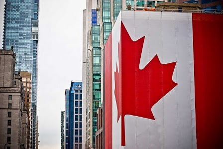 Canadian flag on city building